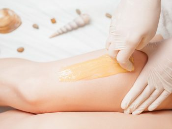 Sugaring epilation skin care with liquid sugar at legs. You can see her smooth and hair free armpits after hair removal.